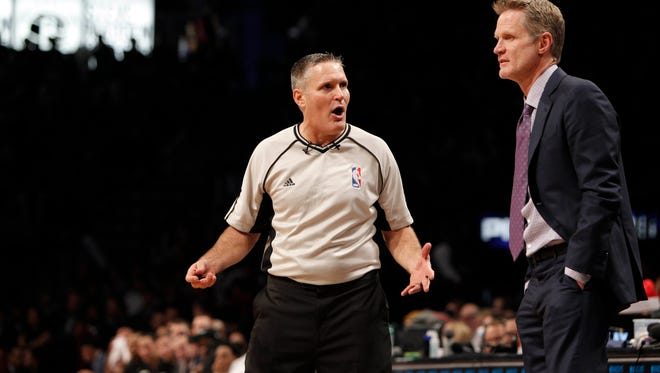 Golden State Warriors head coach Steve Kerr reacts with an official in the fourth quarter agains the Brooklyn Nets at Barclays Center.