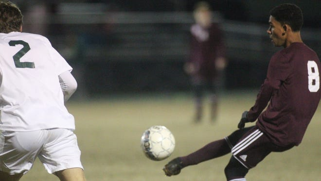 Chiles' Will Johnson plays a ball into the box during a 3-3 draw with Lincoln on Thursday night. Johnson scored a goal in the game.