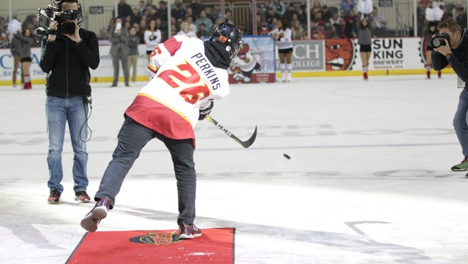 """Mac Perkins slipped a puck through the smallest slot for Indy Fuel's """"Shoot the Puck"""" challenge on Friday, Jan. 5, 2018."""