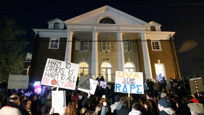 Protestors carry signs and chant slogans in front of the Phi Kappa Psi fraternity house at the University of Virginia Nov. 22.
