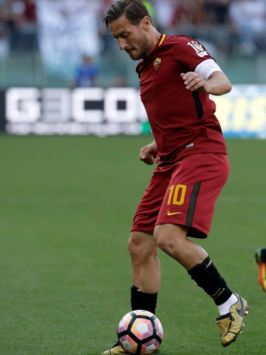 FILE - In this Sunday, May 28, 2017 file photo, Roma's Francesco Totti controls the ball during an Italian Serie A soccer match between Roma and Genoa at the Olympic stadium in Rome. It's been all change at Roma and it will be either sink or swim for new coach Eusebio Di Francesco. Not only will it be Roma's first season in 25 years without Francesco Totti after the talismanic captain retired, but it will also be without sporting director Walter Sabatini and coach Luciano Spalletti.(AP Photo/Alessandra Tarantino, File)