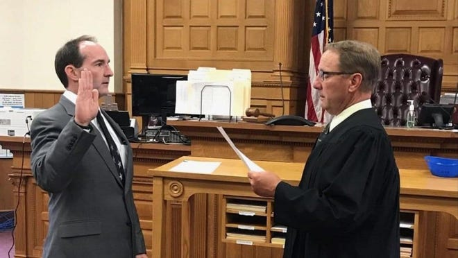 Thomas Siegel, left, was sworn in June 29 as an Assistant State's Attorney for Warren County. The longtime public defender and private attorney won the Republican nomination for State's Attorney in the March primary.