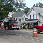 A crew tears up the sidewalk Tuesday at the intersection of West Water and Hoffman streets in Elmira.