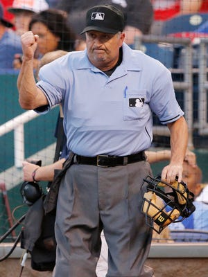 Umpire Dale Scott calls out St. Louis Cardinals' Yadier Molina after a play review in the fifth inning of a baseball game June 5 against the Kansas City Royals at Kauffman Stadium in Kansas City, Mo. Major League Baseball umpire Dale Scott says he is gay. The 55-year-old umpire tells the website outsports.com that he married Michael Rausch in November 2013.