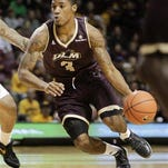 ULM guard Marcus Washington (3) and the Warhawks host Chattanooga on Monday night.