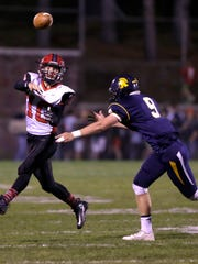Wausau East's Alex Becker throws an incomplete pass under pressure from West's Jacob Pupp during the 47th annual Log Game between Wausau West and Wausau East at Thom Field September 30, 2016.