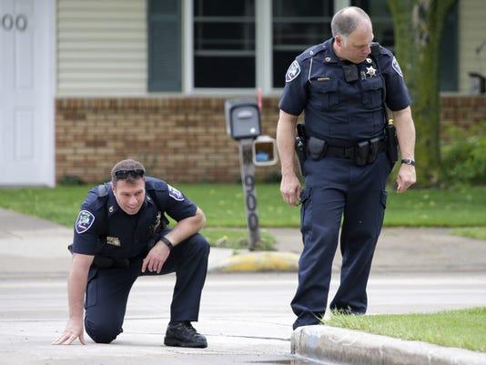 636000285211292330-APC-officer-injured-KensingtonDr-052816-114-wag-.jpg