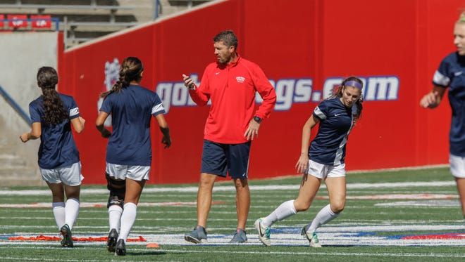 Des Moines native and Fresno State women's soccer coach Brian Zwaschka monitors warm-ups in a 2013 game against Boise State.