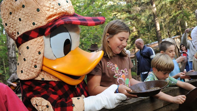 Disney Cruise Line guests pan for gold in Skagway like miners from the famous Klondike gold rush. A special visitor, Donald Duck, might even waddle by to share in the gold-panning fun.