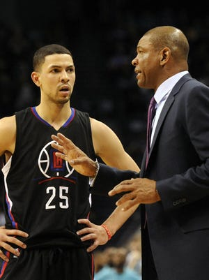 Clippers guard Austin Rivers talks to his father and head coach, Doc Rivers, during a timeout against the Hornets during a December game at Time Warner Cable Arena in Charlotte.