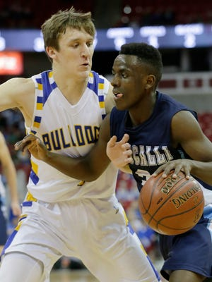 Roncalli's Chombi Lambert gets past Pardeeville's Nicholas Cerro during the second half.  Roncalli Jets played against Pardeeville Bulldogs in the WIAA Division 4 boys basketball semi-final State Tournament, Thursday, March 15, 2018, held at the Kohl Center, Madison, Wis.