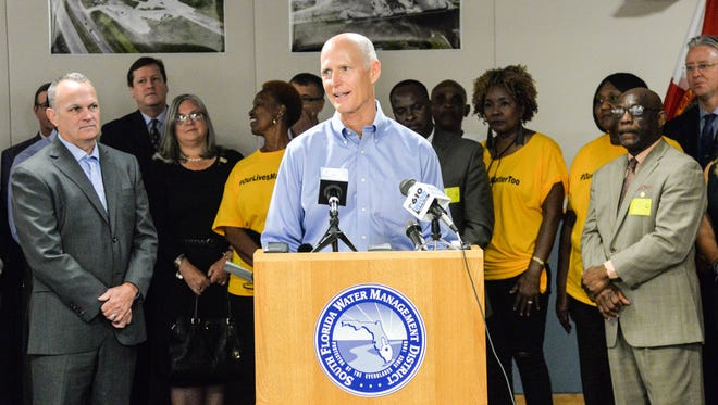 Gov. Rick Scott (center) and House Speaker Richard Corcoran (left) visit the South Florida Water Management District's headquarters in West Palm Beach on Tuesday, June 13, 2017, to tout $50 million the Legislature allocated for Lake Okeechobee dike repairs.
