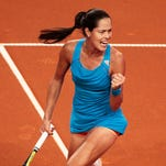 Anna Ivanovic of Serbia celebrates a point during her match against Sabine Lisicki of Germany during Day 3 of the Porsche Tennis Grand Prix.