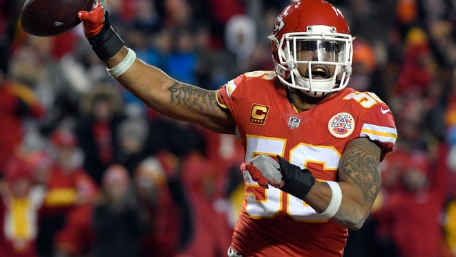 FILE - In this Saturday, Jan. 6, 2018, file photo, Kansas City Chiefs linebacker Derrick Johnson (56) celebrates what he thought was a touchdown on a Tennessee Titans fumble during the second half of an NFL wild-card playoff football game in Kansas City, Mo. Derrick Johnson's tenure with the Kansas City Chiefs is coming to an end. The franchise's career tackles leader and a four-time Pro Bowl selection, Johnson will become a free agent when his contract expires at the start of the new league year March 14, 2018. (AP Photo/Ed Zurga, File)