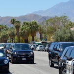 Michelle Obama gets out of the motorcade to board Air Force One departing from Palm Springs, Monday, June 16, 2014.