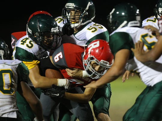 Nick Gil, of Desert Mirage High School runs for yardage against Palo Verde Valley during the Rams game at home in Thermal.