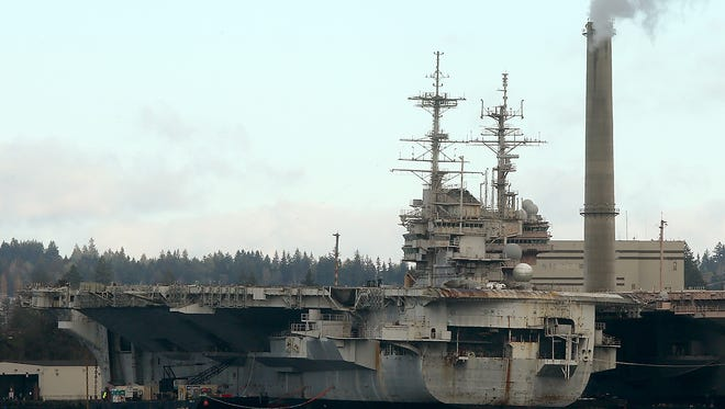 The USS Independence sits at the end of the mothball fleet at Naval Base Kitsap-Bremerton.