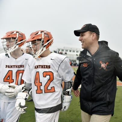 Central York head coach Tom Mayne celebrates with players