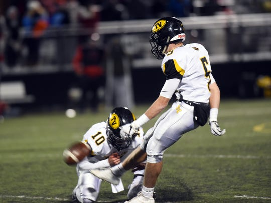 Chase Dinan kicks a game-tying field goal with five seconds left in regulation during Tri-Valley's 36-30 overtime win against Bellefontaine on Friday in a Division III regional semifinal game at Westerville Central.