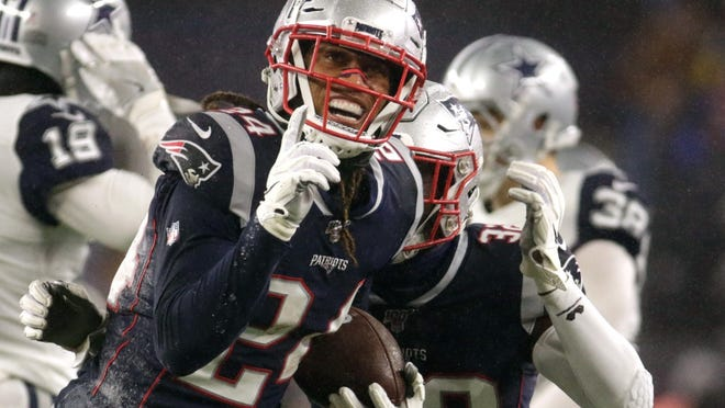 Stephon Gilmore celebrates a second quarter interception against Dallas last season. Gilmore tied for the league lead in interceptions with six en route to being named the NFL Defensive Player of the Year. THE PROVIDENCE JOURNAL / BOB BREIDENBACH]