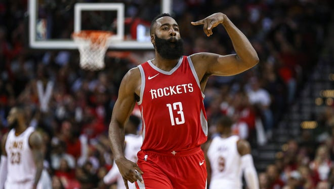 Houston Rockets guard James Harden (13) reacts after making a three point basket during the fourth quarter against the Cleveland Cavaliers at Toyota Center.