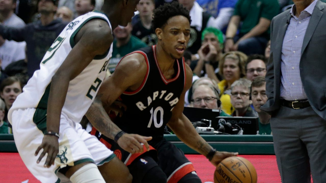 DeMar DeRozan's 33 points and nine rebounds help Toronto win at Milwaukee on Saturday and send their first-round playoff series back to Canada tied at 2-2.