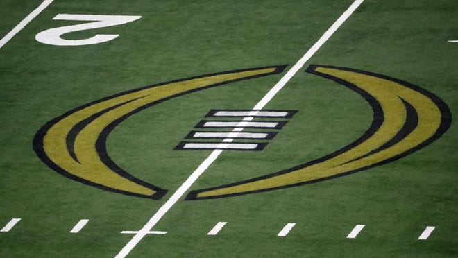 The College Football Championship Playoff logo is shown on the field at AT&T Stadium during the NCAA Cotton Bowl semi-final playoff football game between Clemson and Notre Dame on Saturday, Dec. 29, 2018, in Arlington, Texas.