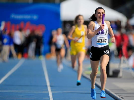 Logan Akason of Waukee crosses the line winning the girls 4x800 relay at the Drake Relays Saturday, April 28, 2018.