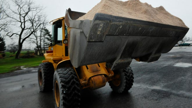 Greg Thomas drives a front-end loader to move pure road salt Wednesday, Dec. 2, 2015 at Guilford Township Maintenance garage at Guilford Springs Road, Chambersburg. Franklin County has the highest road salt price sin the state. The prices overall are the highest in years.