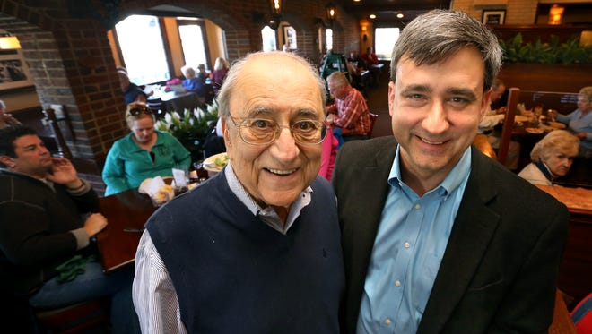 Father and son Jim, left and Peter Demos, right, in their dinning room at their restaurant on Friday March 6, 2015, when the Murfreesboro-based restaurant celebrated its 25th anniversary.