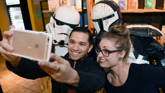 Zeke and Meredith Gonzalez of Jackson snap a selfie with Cameron Bullock, back left, and Brady Shorter, back right, of the 501st Legion's Mississippi Rancor Raiders at Cups in The Quarter on Lakeland Drive in 2015.