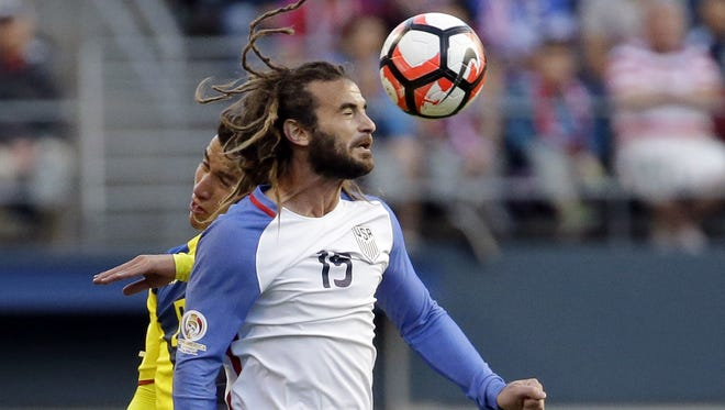 United States' Kyle Beckerman  heads the ball in front of Ecuador's Fernando Gaibor in the second half of a Copa America Centenario soccer match, Thursday, June 16, 2016, at CenturyLink Field in Seattle. The U.S. won 2-1.