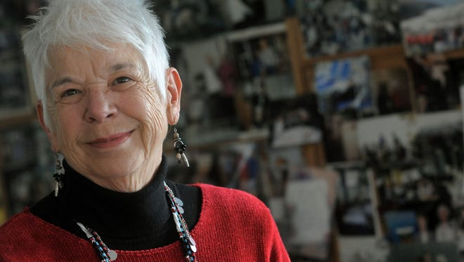 Sylvia Mucklow, pictured with photos from her tours around the world in this 2011 file photo, is owner of Rocky Mountain Travel King, which is celebrating its 50th anniversary in October.