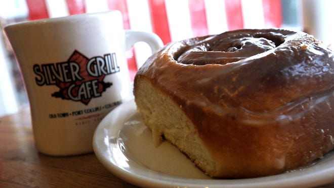 A cinnamon roll is paired with a hot cup of coffee at Silver Grill Cafe.