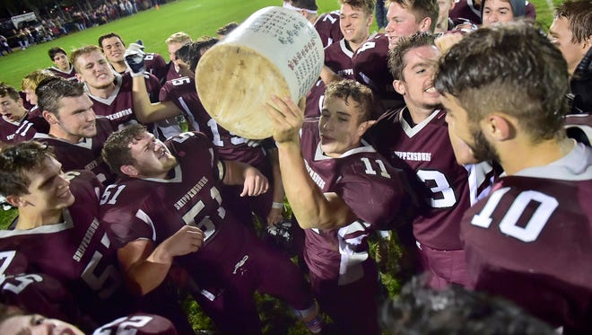 Shippensburg players celebrate with the Little Brown Jug. Shippensburg hosts Big Spring in one of the oldest high school football rivalries in the area on Friday, November 3, 2017 at Memorial Park Stadium. Greyhounds won 27-21.