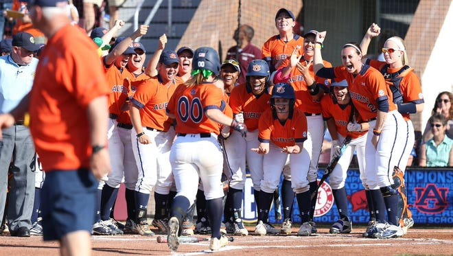Auburn players celebrating the 2-run home run by catcher Carlee Wallace in the first inning of their 2-1 victory over No. 1 Florida in 2016 Southeastern Conference tournament semifinals.