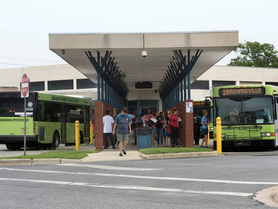 Escambia County Area Transit passengers arrive at the