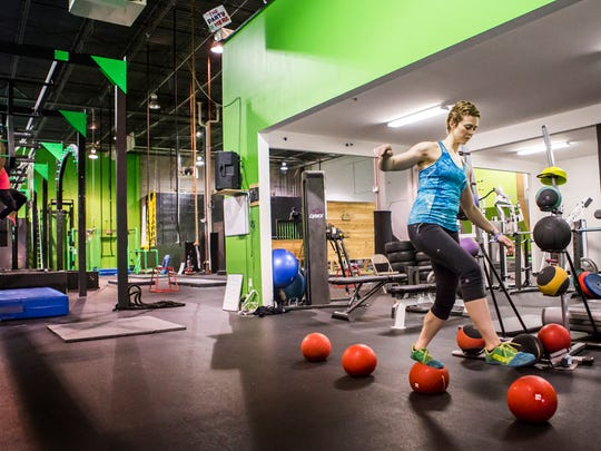 """""""American Ninja Warrior"""" contestant Arianne Missimer trains last month at iCore Fitness in West Chester, Pa."""