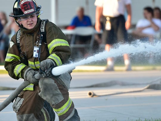 Matthew Birgfeld, Metal Township Volunteer FIre Company, works the hose during competition. Cadets in the Junior Firefighter Academy held a skills challenge on Wednesday, July 20, 2016 at the Franklin County Public Safety Training Center, 3075 Molly Pitcher Highway.