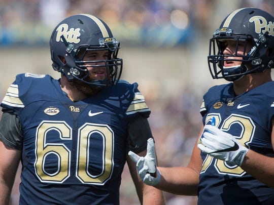 Pittsburgh Panthers offensive lineman Aaron Reese (60) chats with Pittsburgh Panthers defensive lineman Shane Roy (93) at  Heinz Field in Pittsburgh as Penn State fell to Pitt 42-39 on Saturday, Sept. 10, 2016.