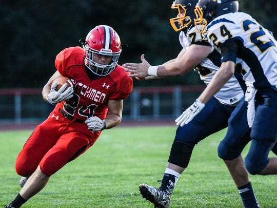 Annville-Cleona's Caleb Turner tries to turn the corner as he's hit by Elco's Travis Weaver in Annville-Cleona's 37-14 win over Elco  on Friday, night.