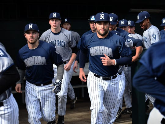 The Nevada baseball team runs out of the dugout on first day of practice Friday at Peccole Park.