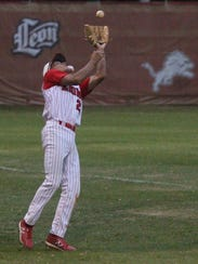 Leon's Victor Castillo catches the second out of the