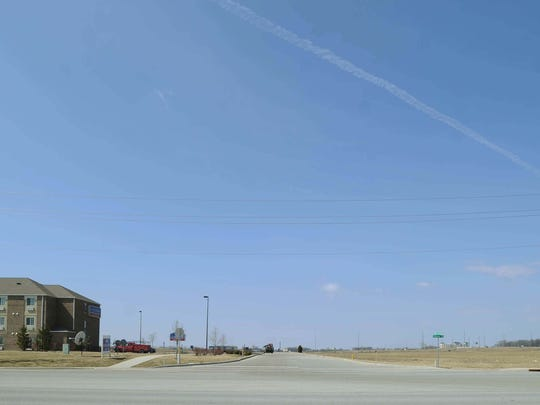 Candlewood Suites hotel, seen Thursday March 20, 2014, shows the vast open space where Cabela's had planned to build a store in Greenwood in 2008 but later decided not to build. This land in Greenwood is southeast of the intersection of County Line Road and I-65.