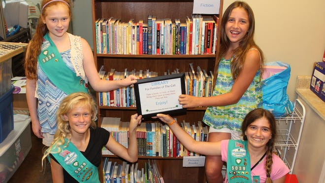 Members of Junior Girl Scout Troop 5039 recently received the Bronze Award.  Pictured are Troop 5039 members, Eliseia Faught and Cora Hadrys and front row, Ella Reno and Trevi Sheaner.  The Bronze Award is awarded to Junior Girl Scouts for making a lasting impact on their community by completing a service project.  For their service project, Troop 5039 planned and established a Library of children's and youth books at The Call, a support organization for children in foster care. They ran a book drive, set up shelving, and opened the Library with more than 150 books. The troop plans to sustain the Library with annual book drives.