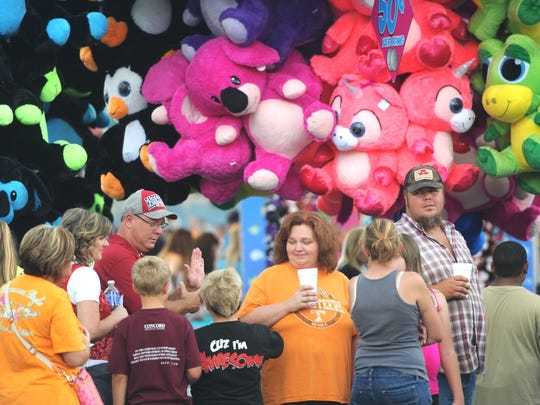 Fairgoers wait in line to buy ride tickets during the Tennessee Valley Fair's opening day at Chilhowee Park on Sept. 11, 2015.