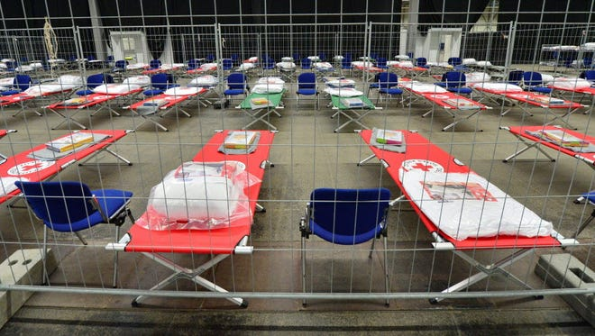 Temporary beds for migrants are set up at a fairground in Erfurt, Germany, on Sept. 8.