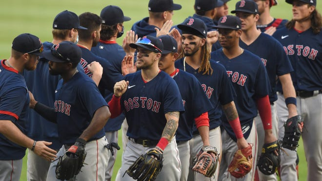 Red Sox celebrate on the infield after defeating the Braves, 9-1, on the final game of the regular season in Atlanta.
