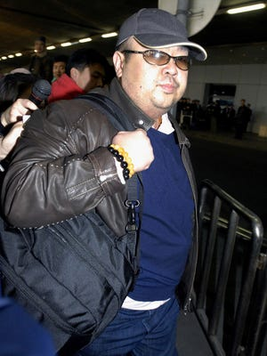 This file photo taken on Feb. 11, 2007, shows a man believed to be then-North Korean leader Kim Jong Il's eldest son, Kim Jong Nam, walking among journalists upon his arrival at Beijing's international airport.