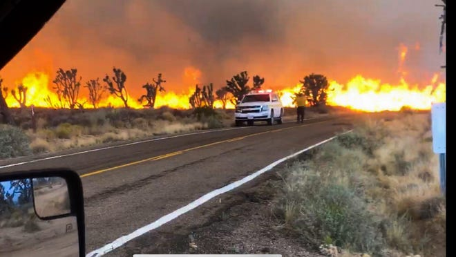 The Dome Fire burns near Cima Road in the Mojave National Preserve on Sunday, Aug. 16, 2020. The blaze charred more than 20,000 acres by Sunday evening.